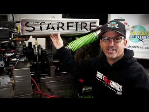 Robert Allen of Truckmount Forums wearing a TruckMount Forums sweater in front of a machine that says Starfore