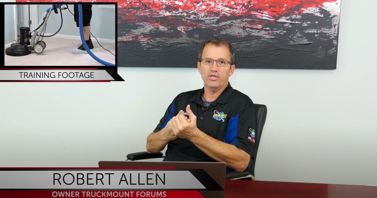 Screenshot of TruckMount Forums Youtube Video with Robert Allen sitting at a table
