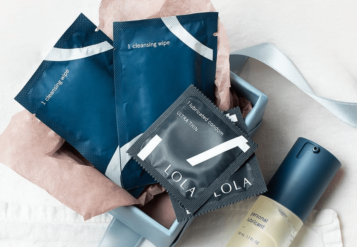 Basket of LOLA products including condoms, lubricant and cleansing wipes.png