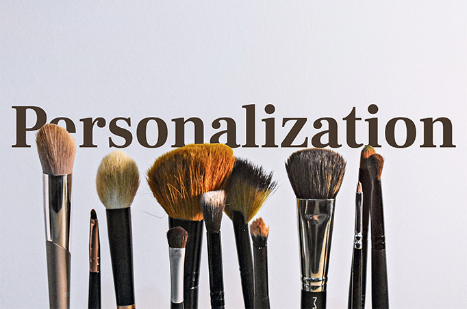 make up brushes in-front of the word personalization