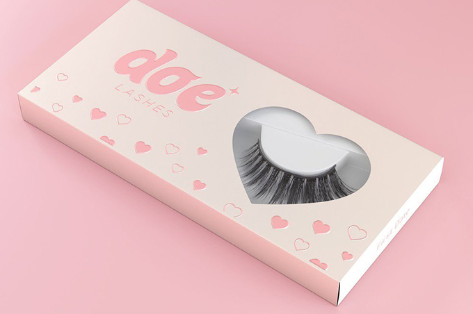Doe Lashes false lash box on top of a pink background